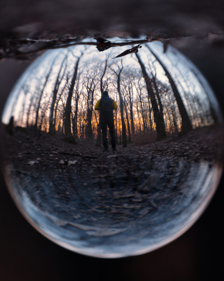 Sunset view through Crystal Ball in Hvězda Forest