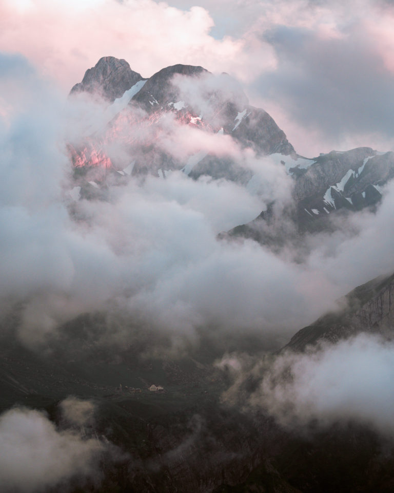 Sunrise and clouds over Meglisalp in Alpstein